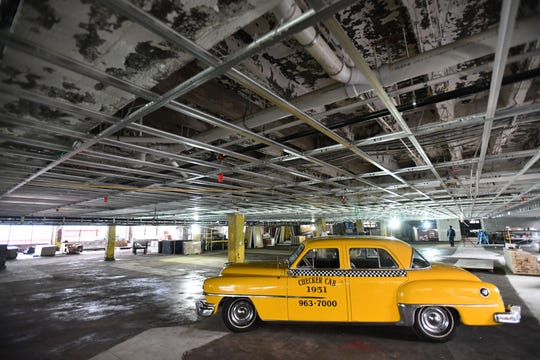 A 1951 Checker Cab was found, covered with a tarp, at the start of the project, in the future first -floor parking area.