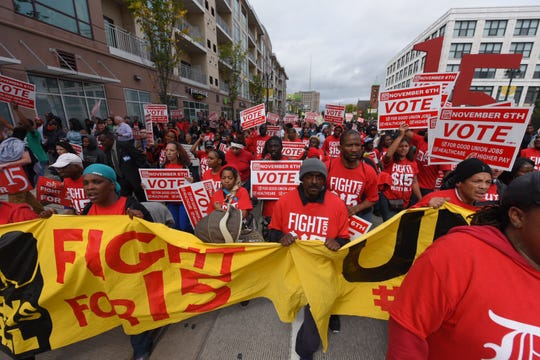 Fight for $15 protesters march down Woodward in Detroit on Tuesday, Oct. 2.