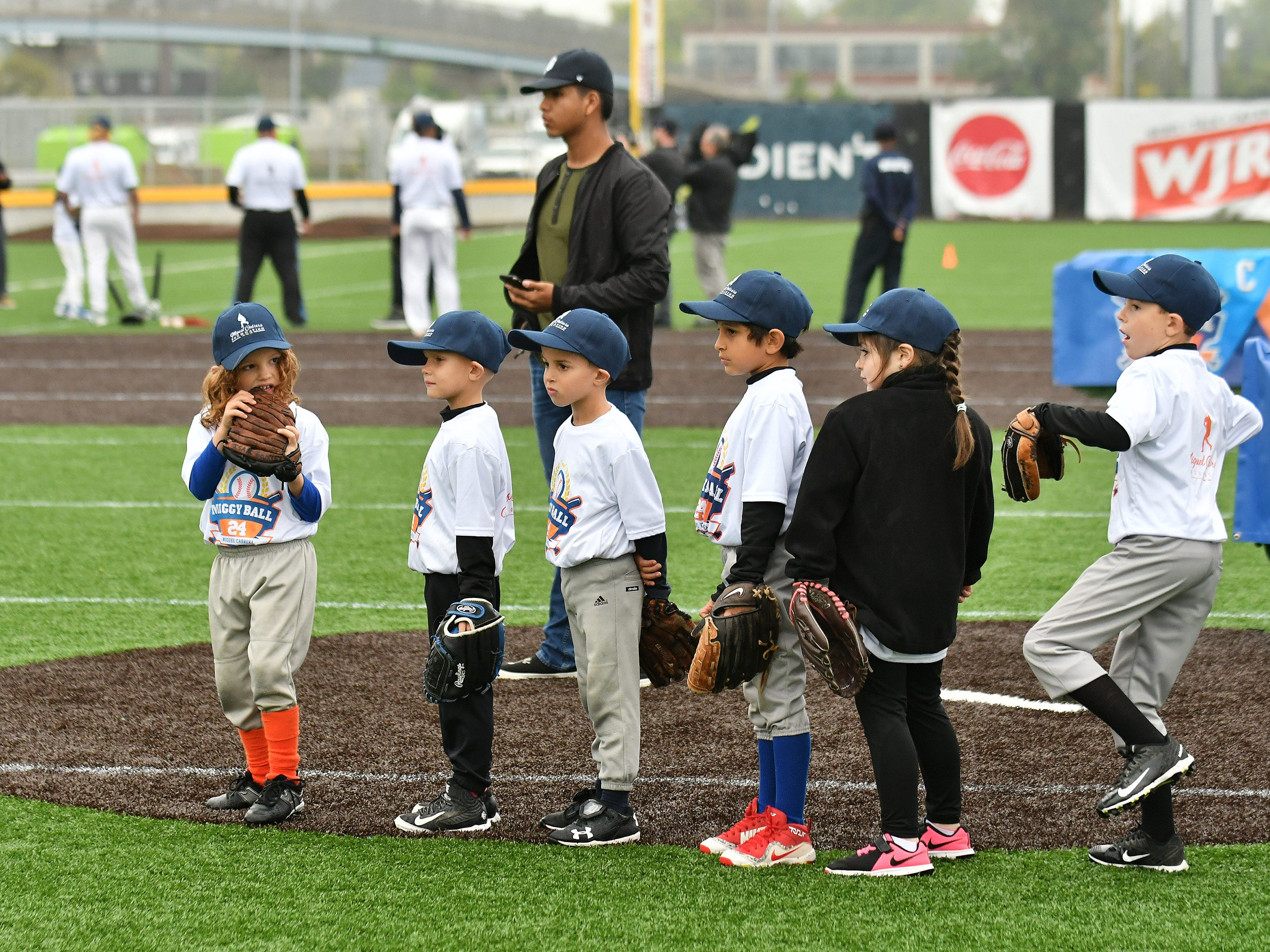 Isaac Gourley, 6, left, looks towards the other participants and the only girl, Rosalie Plascencia, 7, of Detroit, in black, at the Miggy Ball 24 event.