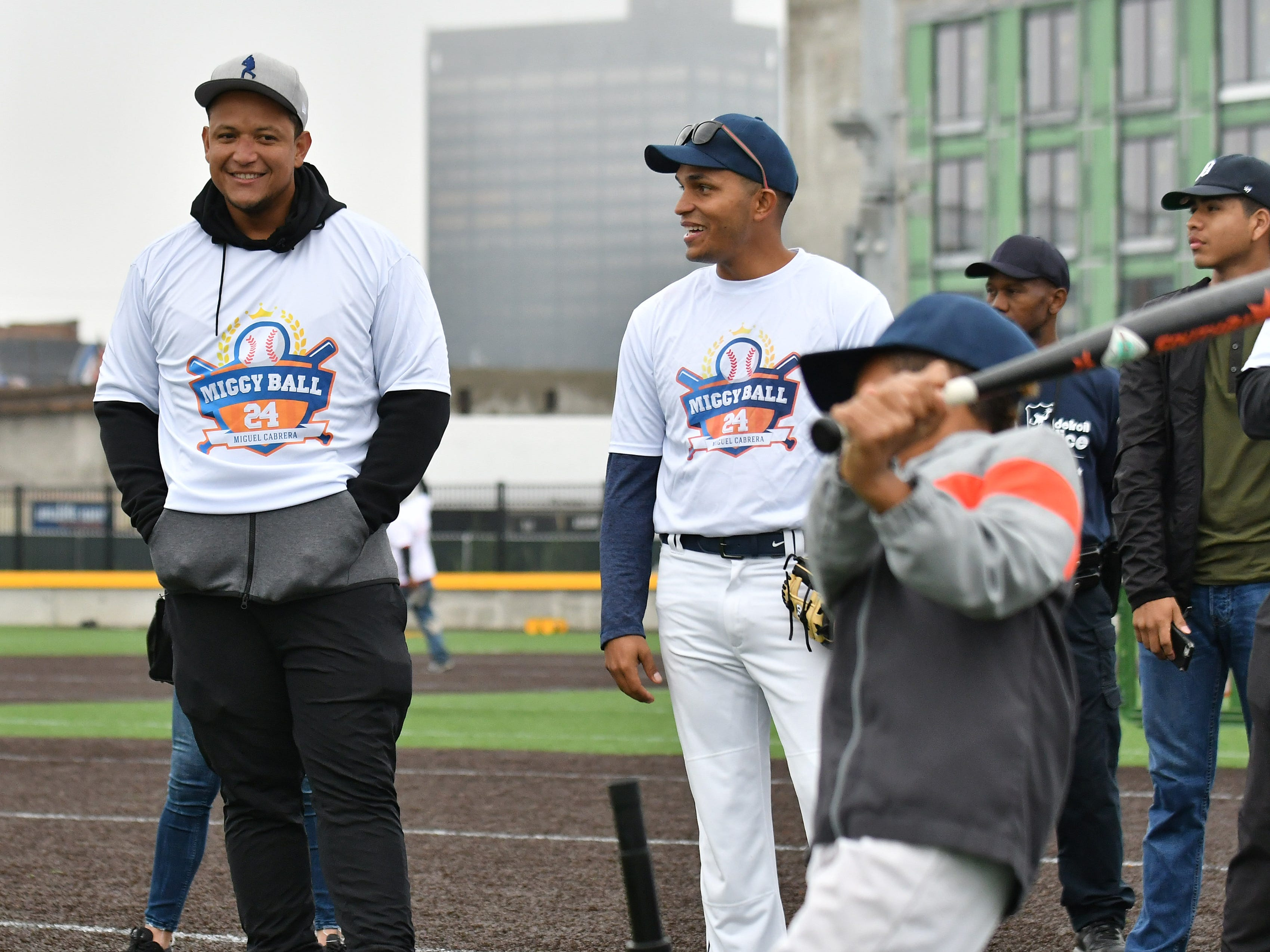 Tigers' Miguel Cabrera watches the Brandon Williams, right, bat with Elison Elias, center, one of the event organizers at the Miggy Ball 24 event.