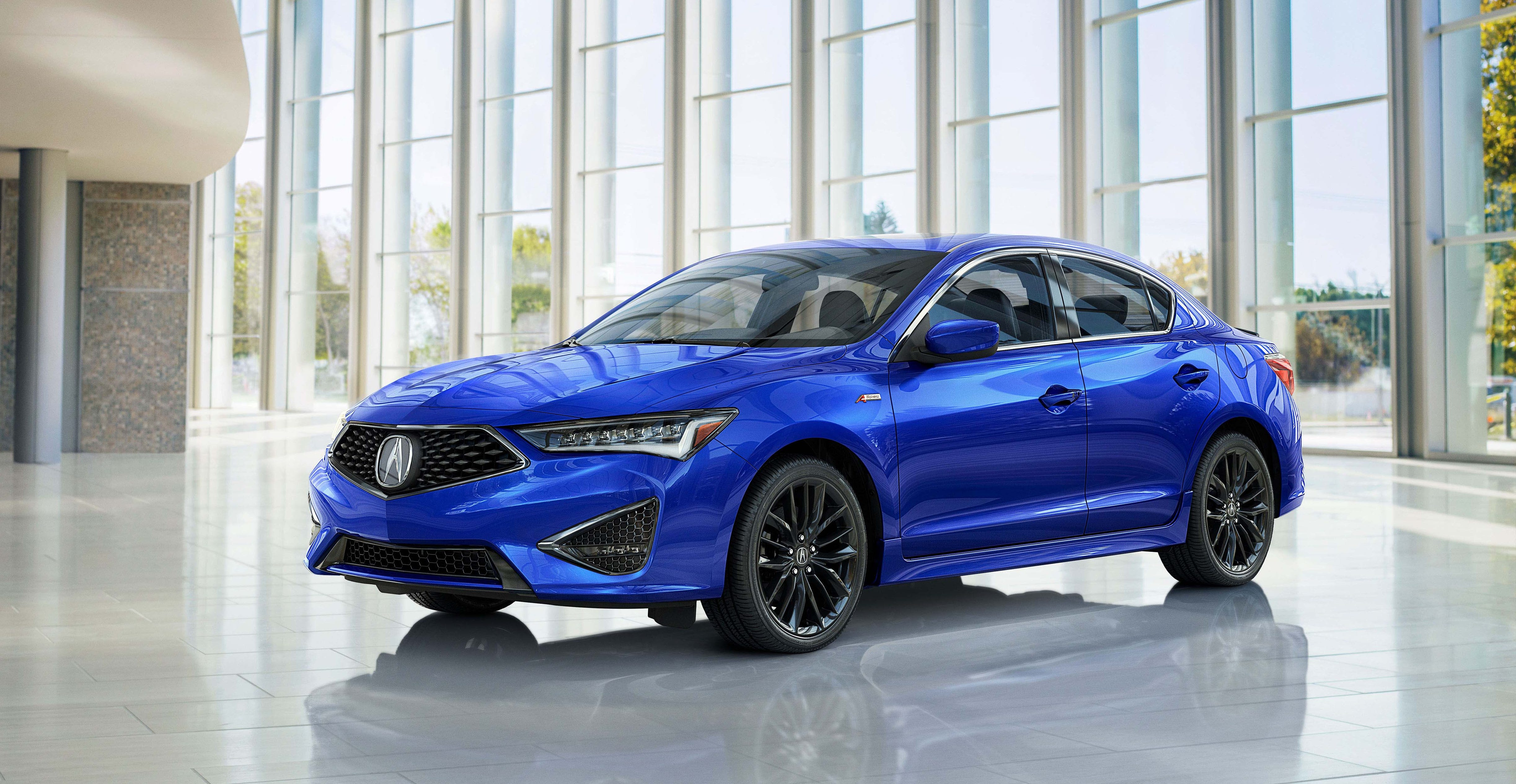 """The refreshed2019 Acura ILX gets the brand's signature Diamond Pentagon grille, """"Jewel Eye"""" LED headlightsand more-sculpted wheels."""