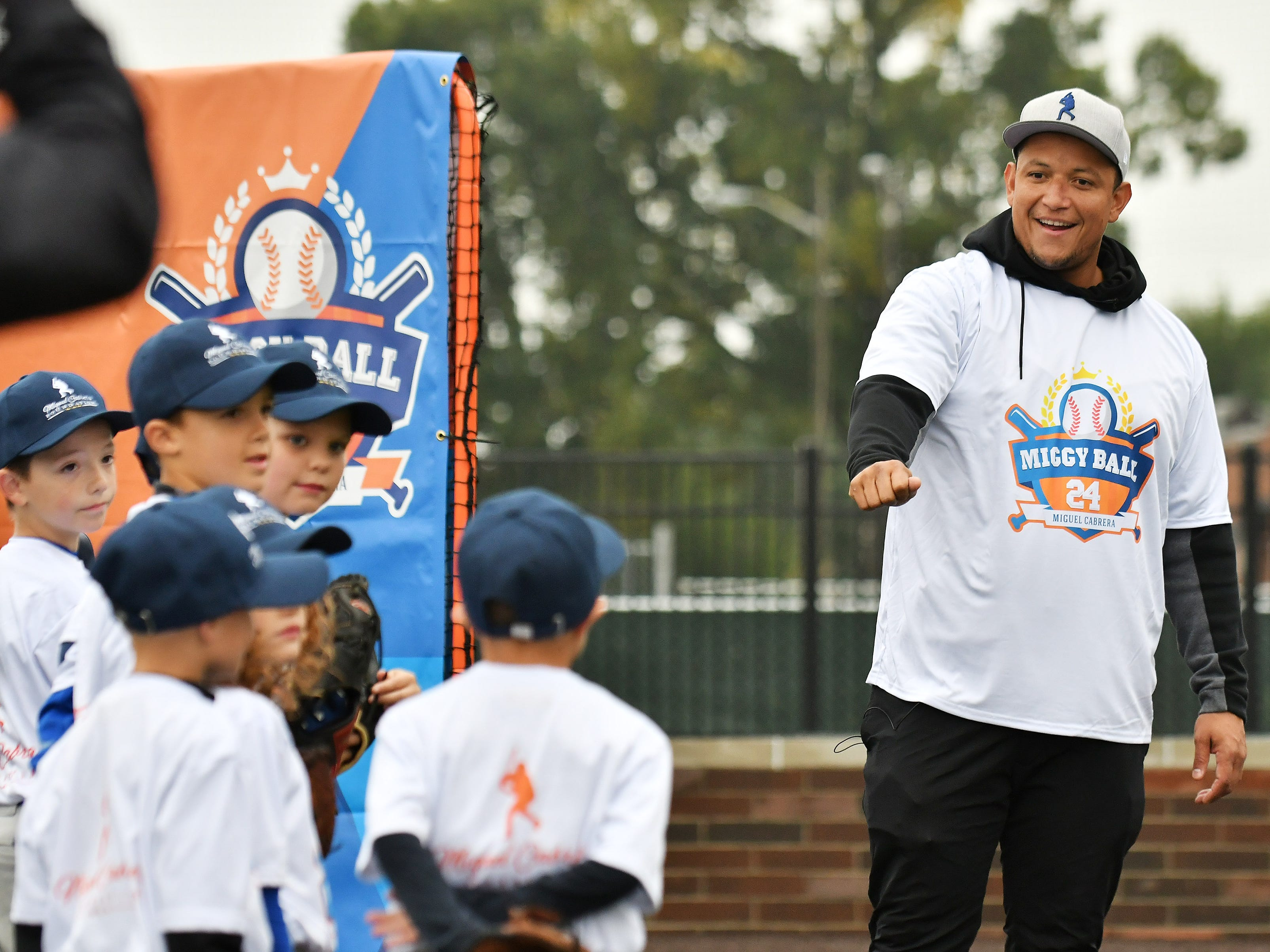 Tigers' Miguel Cabrera greets the kids at the Miggy Ball 24 event.