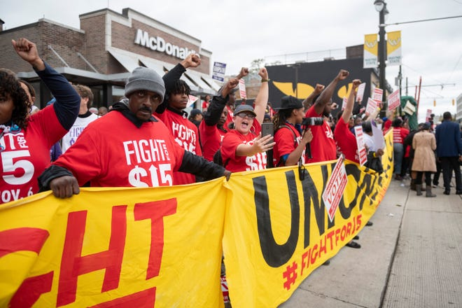 Protesters demonstrate in front of the McDonald's on Woodward near Canfield during a protest supporting a raise in the minimum wage to $15 an hour and demanding a union at fast-food restaurants on Oct. 2, 2018.