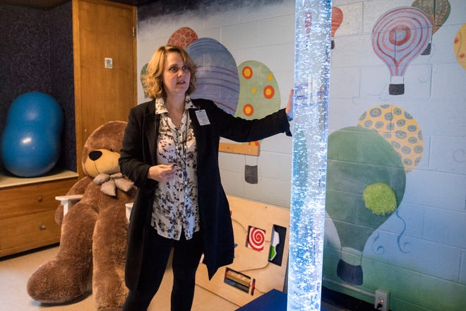 Dr. Shannon Jones, medical director and interim superintendent for the Evansville Psychiatric Children's Center, describes the benefits of the stress free zone for sensory seeking children the hospital offers during a tour the facilities Tuesday, Oct. 2, 2018.