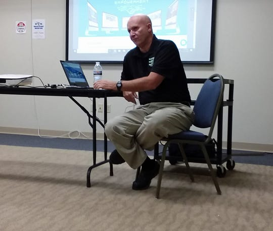 Scott Frank as he instructs the group on using Facebook and other social media.