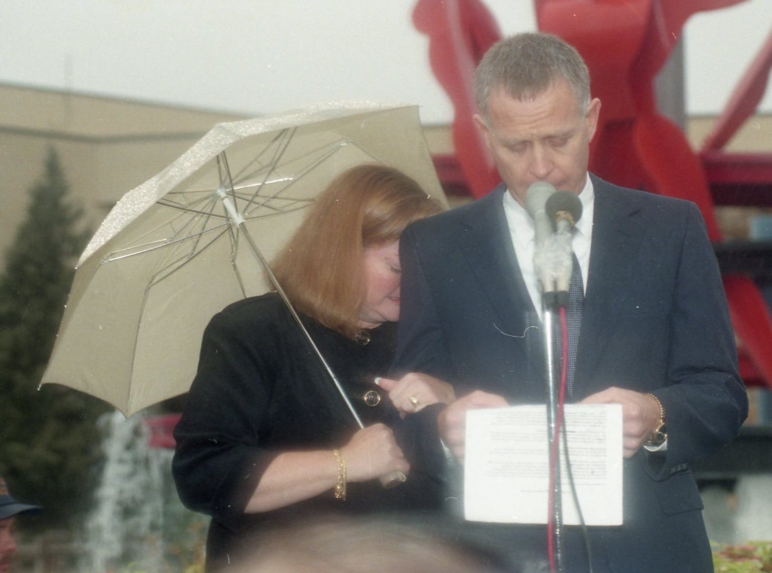 Dennis Shepard, with his wife Judy, speaks outside Casper City Hall on October 16, 1998, the day of their son Matthew's funeral.