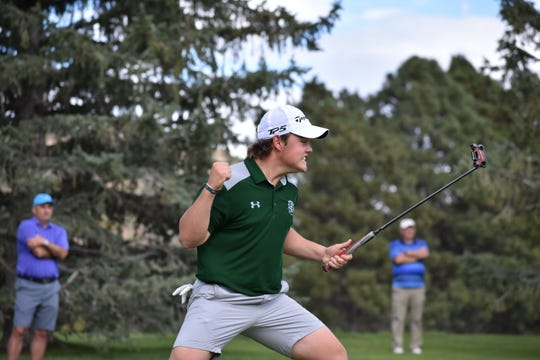 Fossil Ridge's Dillon Stewart celebrates hitting a birdie put on hole No. 17 to take the lead eventually win the tournament at the 5A state golf tournament at Colorado Springs Country Club.
