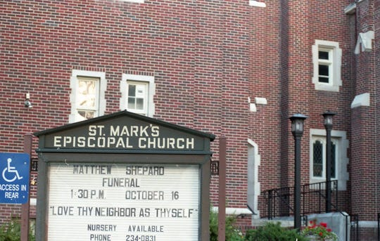 The sign outside the church where Matthew Shepard's funeral was held including information about the funeral.