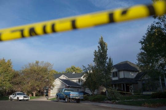Crime scene tape blocks off the end of a cul-de-sac where a homicide occurred early Tuesday morning, Oct. 2, 2018, on the 3000 block of Blue Leaf Court near South Overland Trail and West Drake Road in Fort Collins, Colo. One person has been arrested on suspicion of first degree murder and domestic violence.