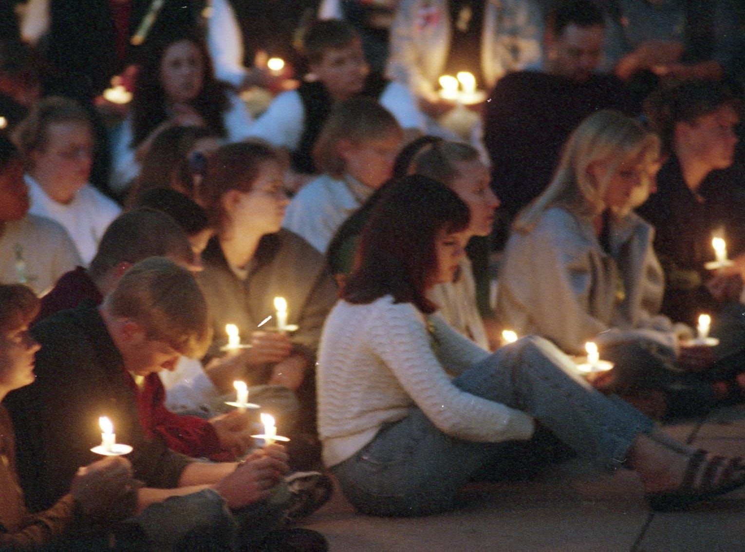 Colorado State University students gather on Tuesday, October 13 for a candlelight vigil for University of Wyoming student Matthew Shepard. Shepard died the previous morning.