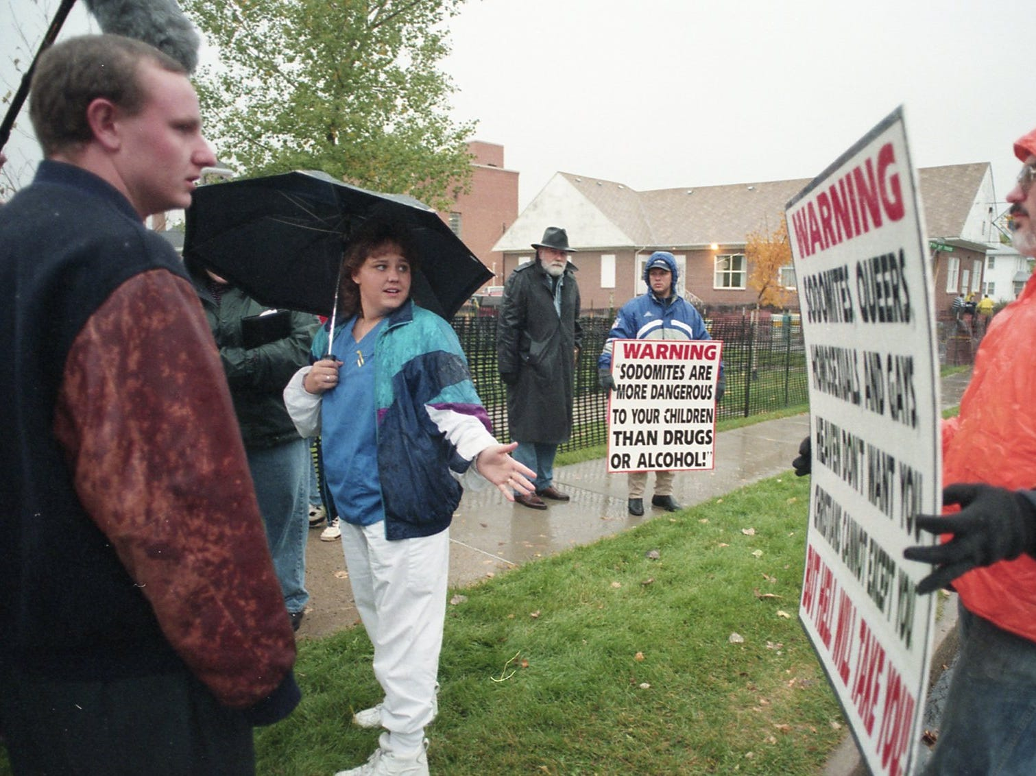 A protestor and a funeral attendee outside the church where Matthew Shepard's funeral was held.