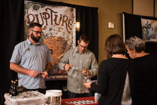 Staff from Odell Brewing pour at a past The Taste Benefit.