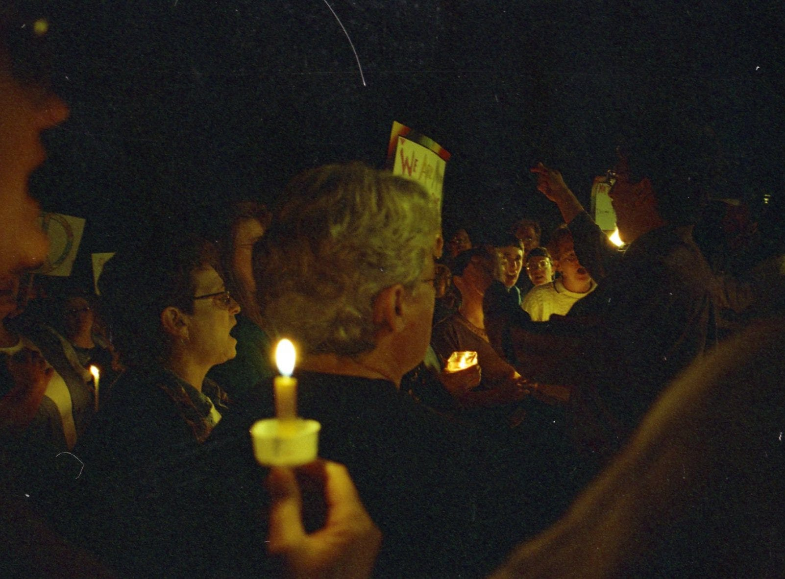 Members of the Fort Collins community gather for a vigil for Matthew Shepard, a University of Wyoming student who fought for his life at Poudre Valley Hospital after a fatal beating on October 7, 1998.