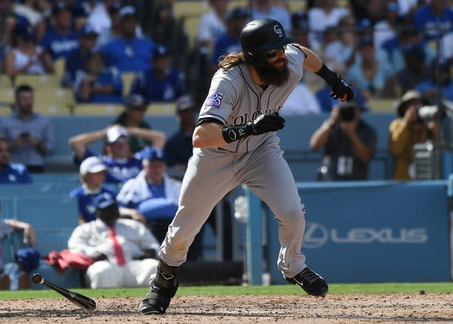 October 1, 2018; Los Angeles, CA, USA; Colorado Rockies center fielder Charlie Blackmon (19) hits a single against the Los Angeles Dodgers during the sixth inning in the National League West division tiebreaker game at Dodger Stadium. Mandatory Credit: Richard Mackson-USA TODAY Sports