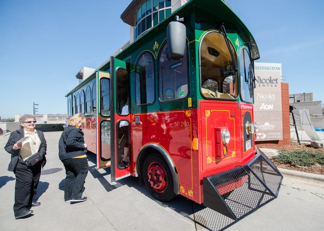 Passengers board the Packers Heritage Trail trolley.