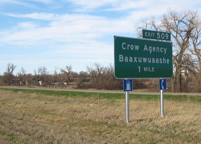FILE - This April 10, 2006 file photo shows a sign along Interstate 90 on the Crow Indian reservation near Crow Agency, Mont., with the tribal word for the community as part of an effort to share the tribe's story with travelers. (AP Photo/Becky Bohrer, File)