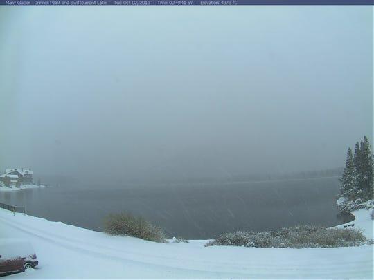 Snow falls at Many Glacier in Glacier National Park Tuesday morning.