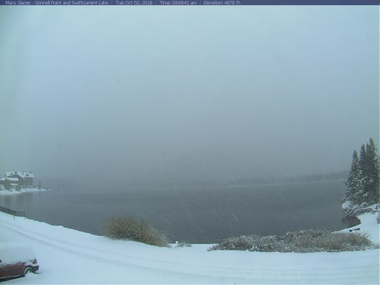 Snow falls at Many Glacier in Glacier National Park Tuesday morning.