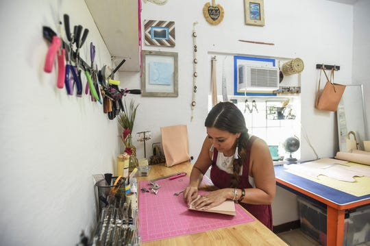 The Blue Latitude owner Abby Crain cuts, sews and stamps each of her products by hand. The process can take hours to create each piece.
