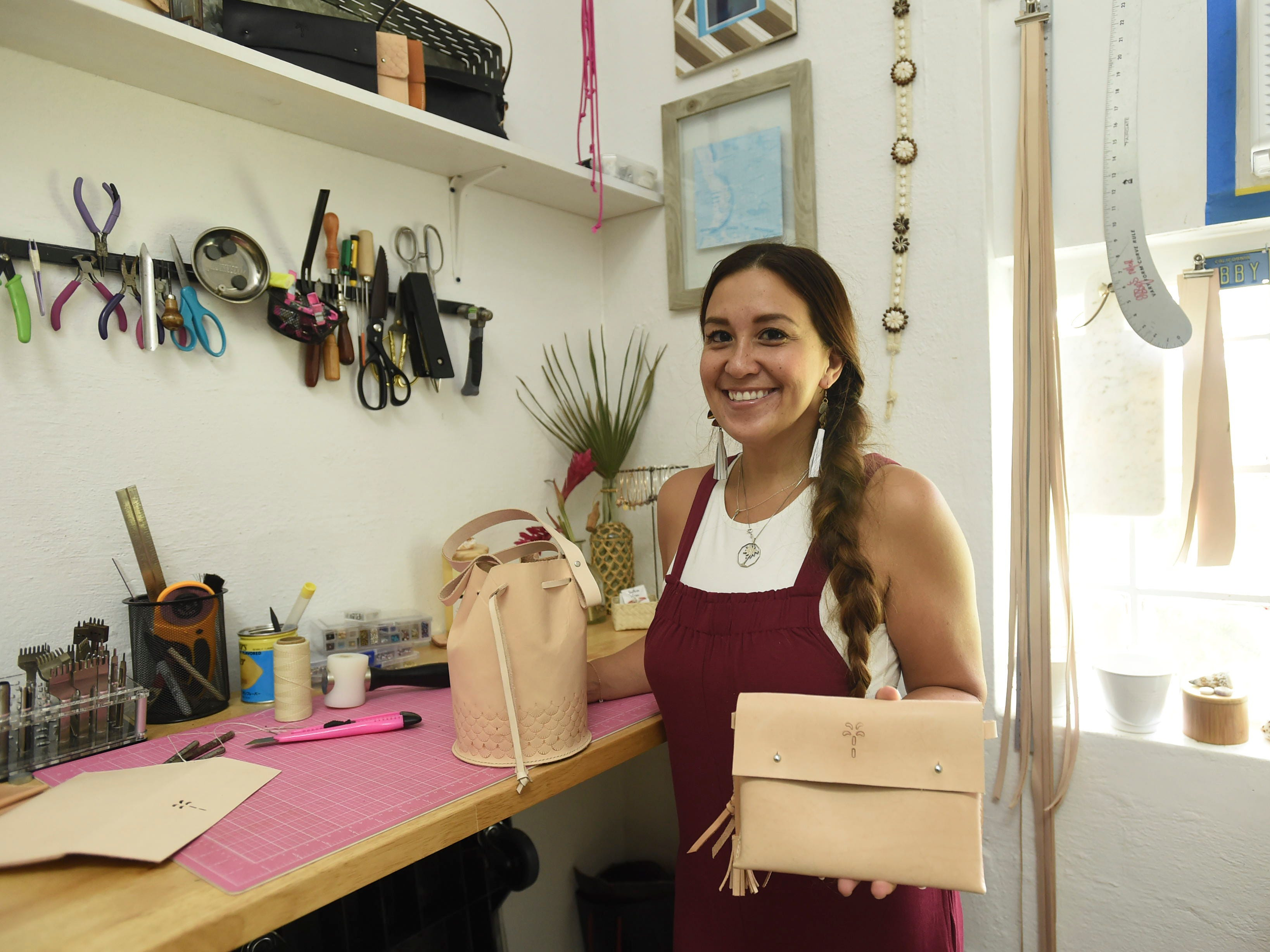 The Blue Latitude owner Abby Crain displays some of her handmade products at her workstation in Merizo on Oct. 2, 2018.