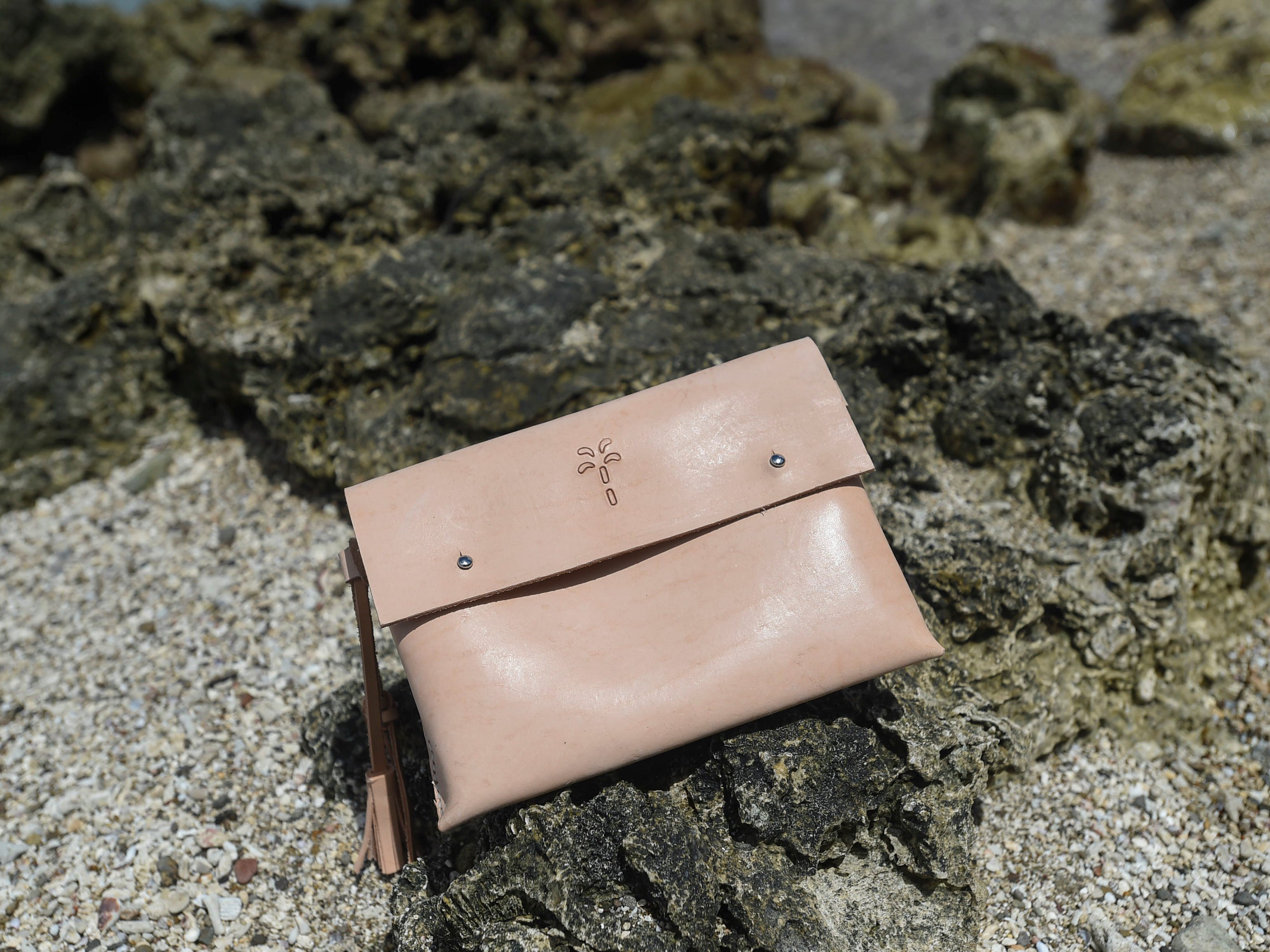 A clutch, handcrafted by The Blue Latitude owner Abby Crain.