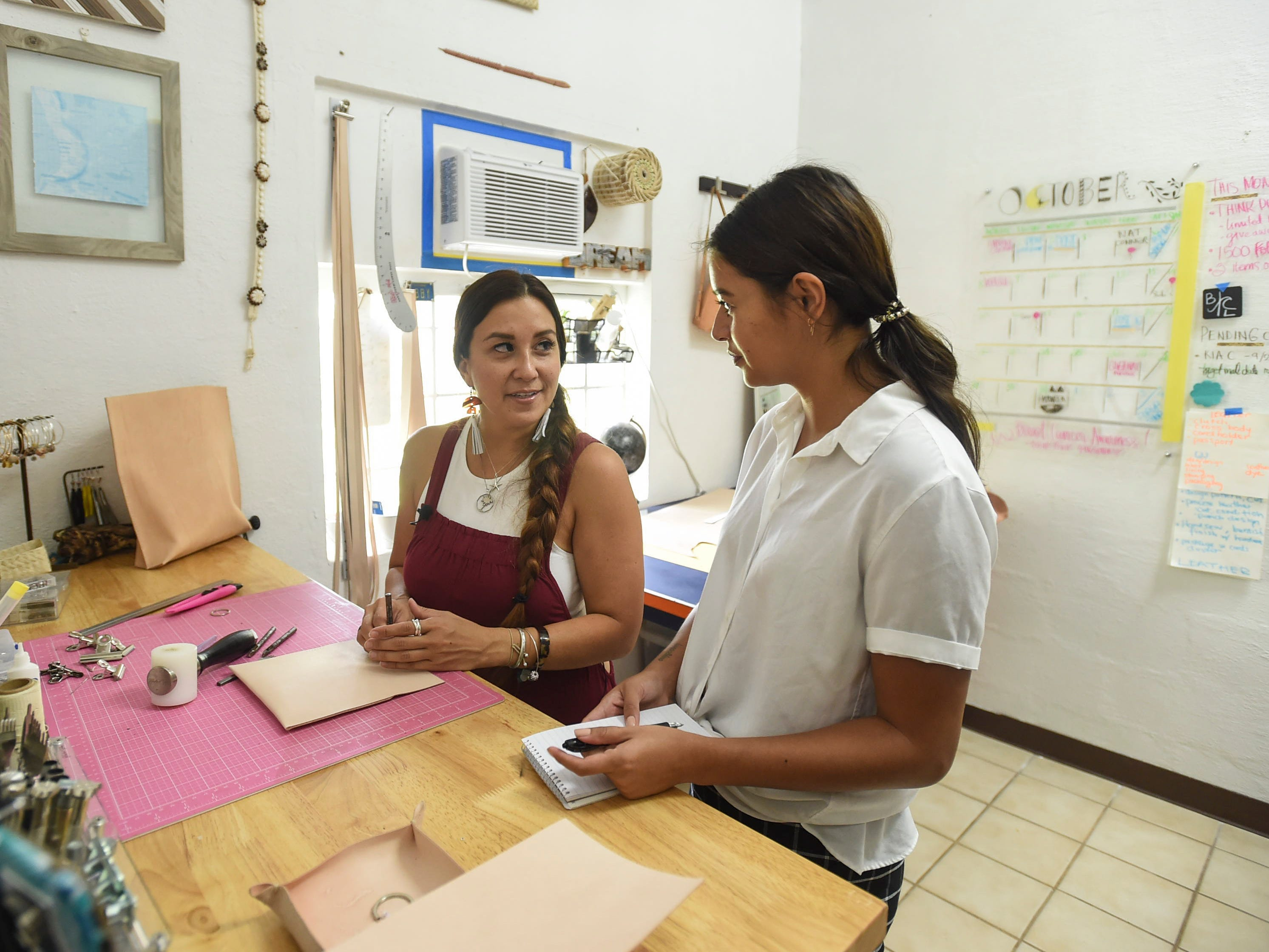Pacific Daily News reporter Chloe Babauta, right, interviews The Blue Latitude owner Abby Crain in Merizo on Oct. 2, 2018.