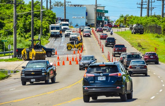 Traffic is rerouted around a Hawaiian Rock Products Guam crew as they complete repairs on Route 8 near the Canada-Toto Loop Road in Barrigada in this Oct. 2, 2018, file photo. Hawaiian Rock will be making various spot repairs at the Route 8 and Canada-Toto Loop intersection from 8 a.m. to noon May 4.