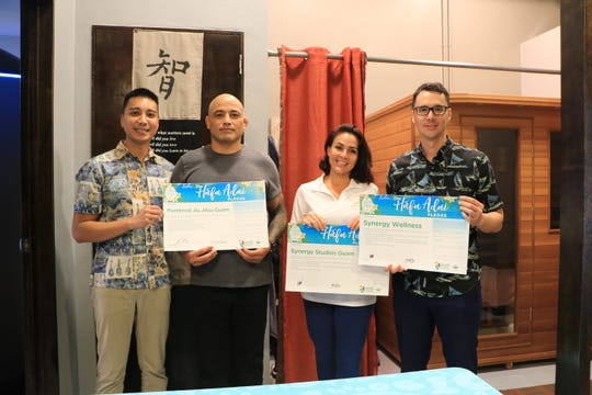 Synergy Studios Guam, Synergy Wellness Center, and Purebred BJJ join together to take the Håfa Pledge in Hagåtña on Sept. 28. Pictured from left: Josh Tyqiuengco, GVB public information officer; Stephen Roberto, Purebred BJJ Guam owner; Clare Calvo, Synergy Studios co-owner and Synergy Wellness Center president; and Nathan Denight, GVB president and CEO.