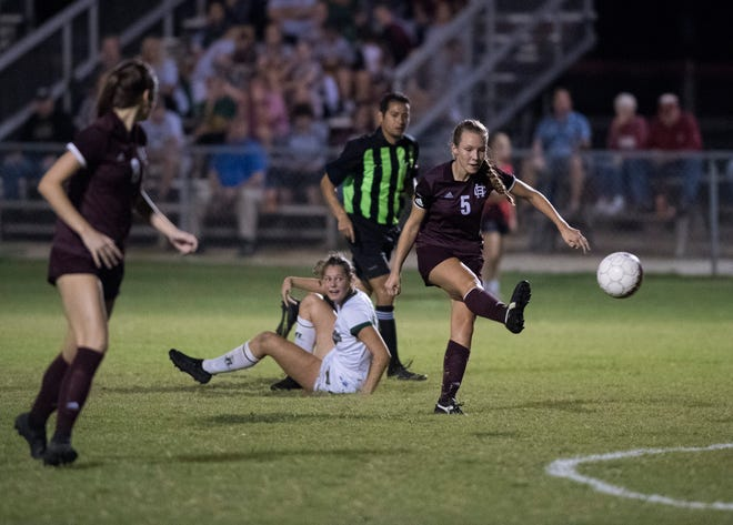 Henderson's Maddie Griggs (5) kicks the ball towards the goal during the second half at Colonel Field in Henderson, Ky., Monday, Oct. 1, 2018. The Gators defeated the Lady Colonels, 4-2.