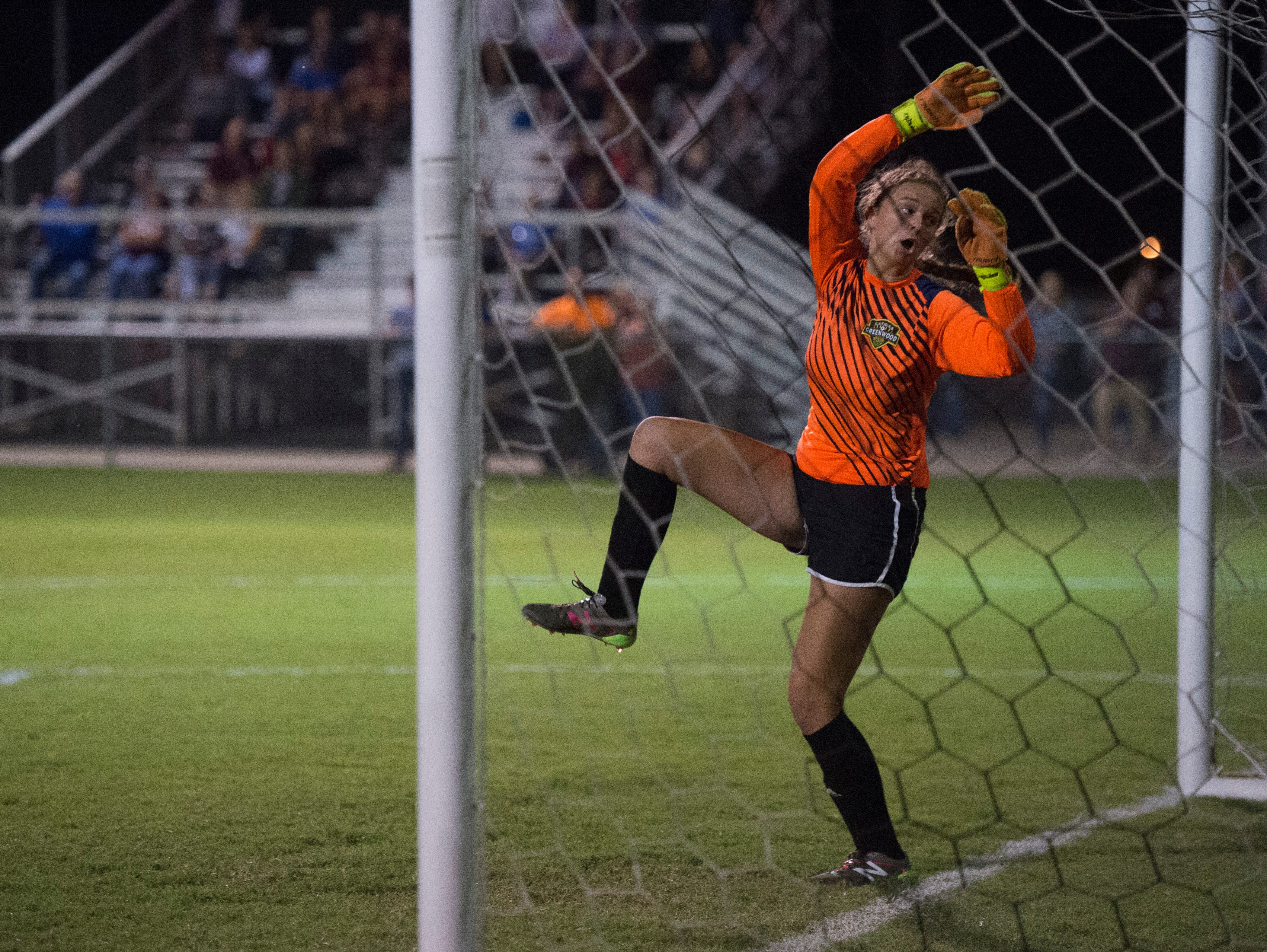Greenwood's Elizabeth DeMarse (0) is shocked after the ball enters the net just out of reach during the Henderson County vs Greenwood match at Colonel Field in Henderson, Ky., Monday, Oct. 1, 2018. The Gators defeated the Lady Colonels, 4-2.