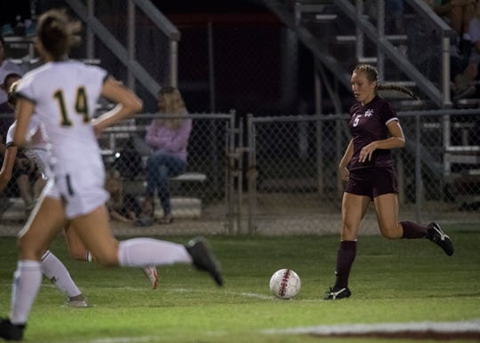 Henderson's Maddie Griggs (5) runs down the field during the second half against Greewood at Colonel Field in Henderson, Ky., Monday, Oct. 1, 2018. The Gators defeated the Lady Colonels, 4-2.