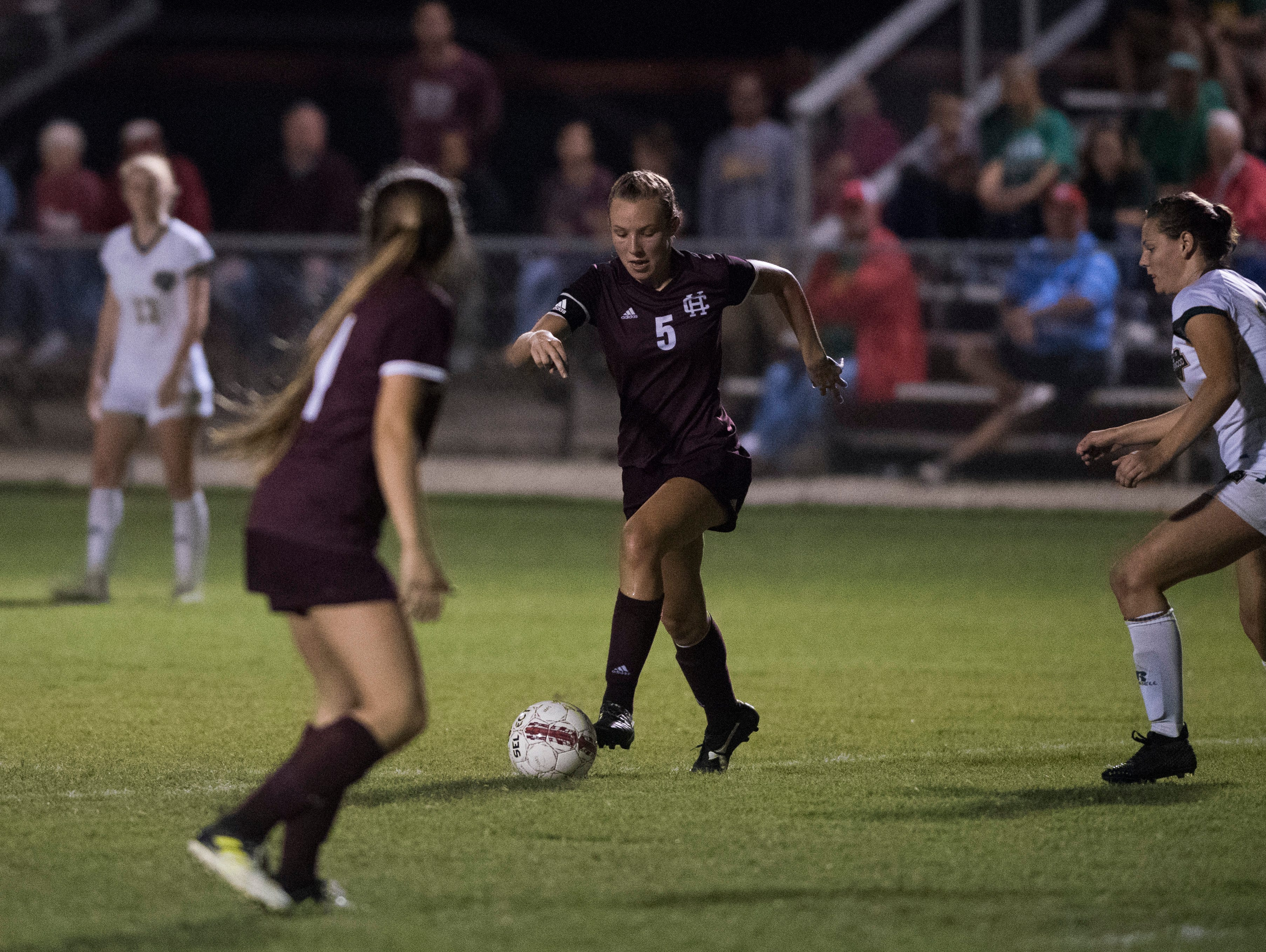 Maddie Griggs (5) ties the state record for career goals while competing in the Henderson County vs Greenwood match Monday, Oct. 1, 2018.