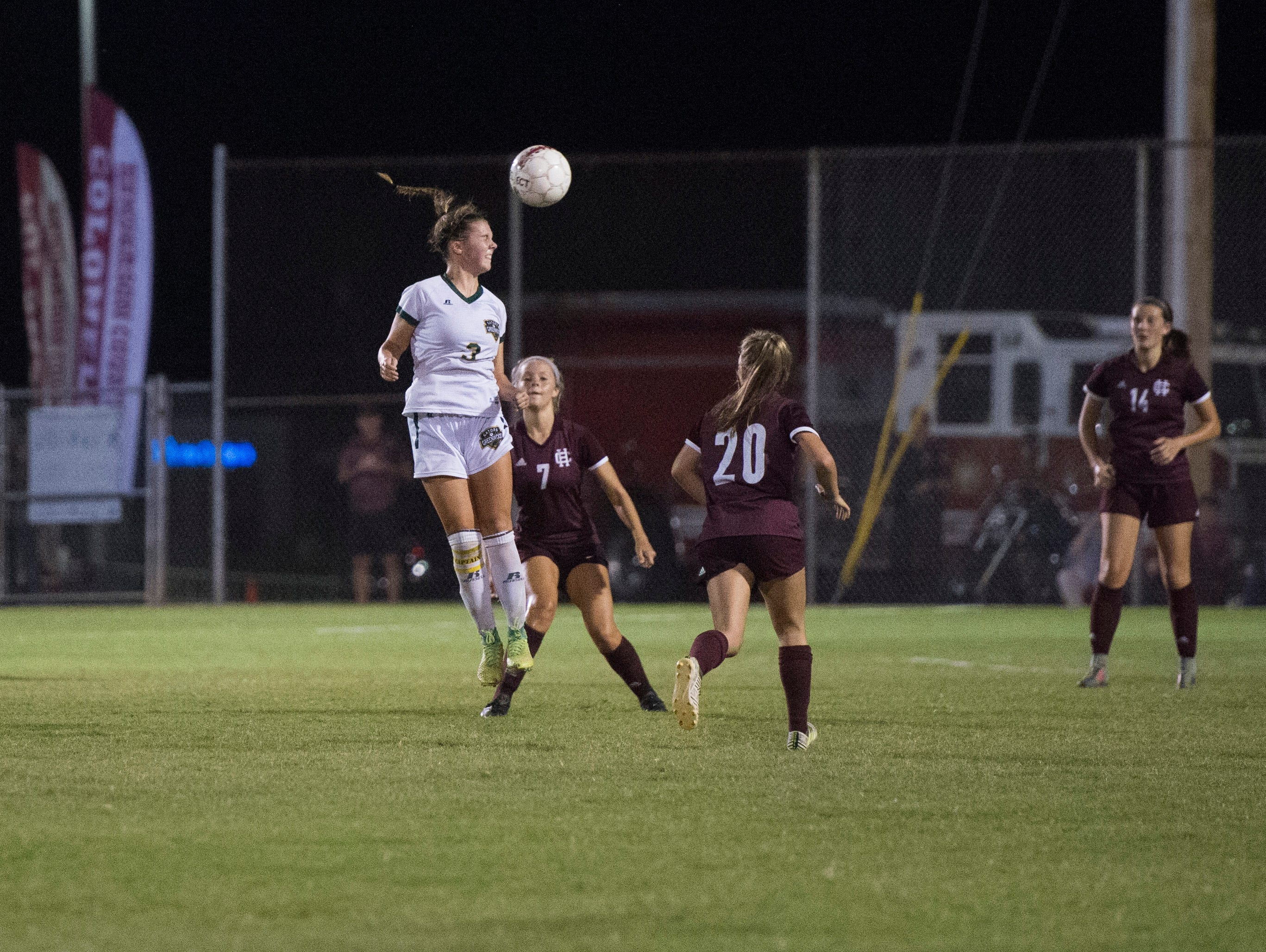 Greenwood's Anna Haddock (3) heads the ball during the Henderson County vs Greenwood match at Colonel Field in Henderson, Ky., Monday, Oct. 1, 2018. The Gators defeated the Lady Colonels, 4-2.