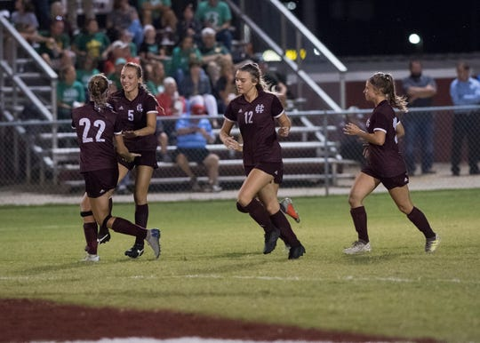 Henderson Lady Colonels celebrate after a goal made by Henderson's Maddie Griggs (5) during the second half at Colonel Field in Henderson, Ky., Monday, Oct. 1, 2018. The Gators defeated the Lady Colonels, 4-2.