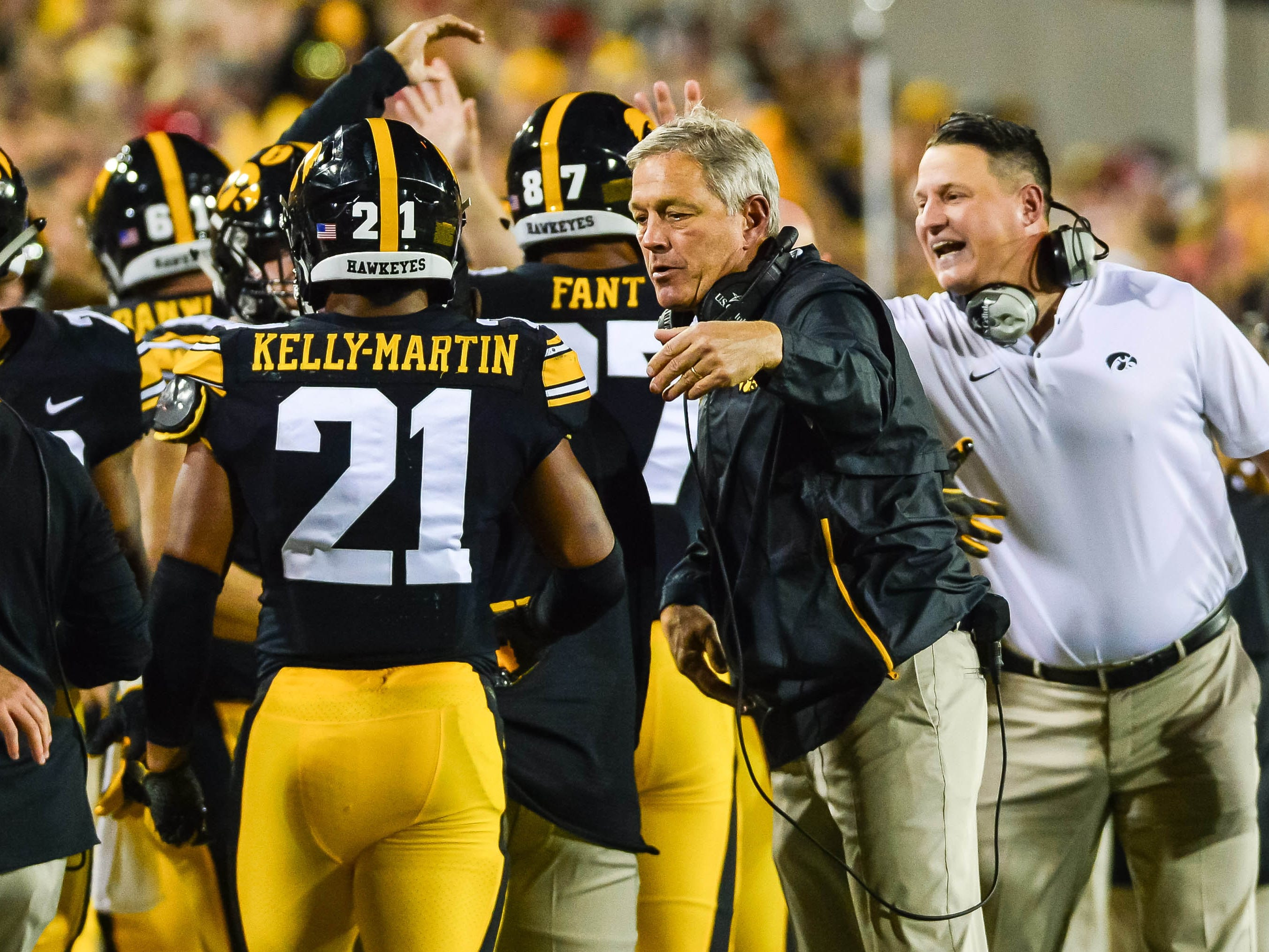 Iowa head coach Kirk Ferentz and assistant coach Brian Ferentz react with running back Ivory Kelly-Martin (21) during the Wisconsin game. The Hawkeyes have tweaked their bye-week routine a little bit with hopes of getting an improved showing over past years.