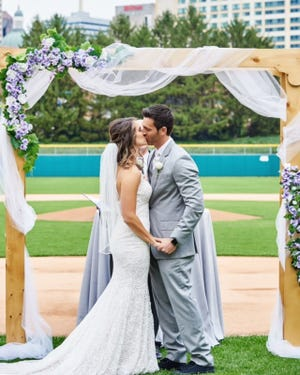 Sarah Johnson and Aaron Puntarelli were married Saturday night at Victory Field.