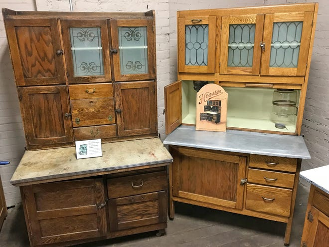 On the left is a Marion Kitchen Cabinet, manufactured by the Dearborn Desk Manufacturing Company of Marion, Indiana while an original Hoosier Cabinet is on display on the right at the Hoosier Cabinet Museum at Coppes Commons in Nappanee, Indiana on Wednesday, Sept. 26, 2018.