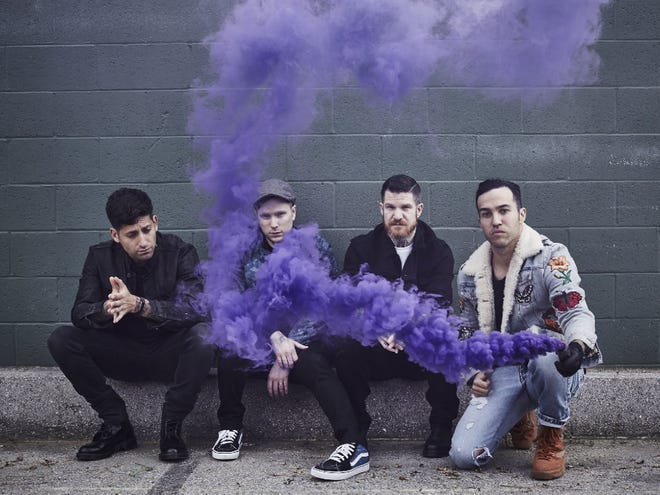 Fall Out Boy (from left, Joe Trohman, Patrick Stump, Andrew Hurley and Pete Wentz) will perform Oct. 7 at Bankers Life Fieldhouse.