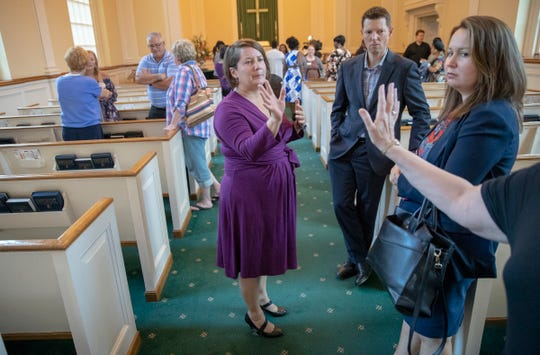 Kelly McBride (middle), Executive Director at Domestic Violence Network, chats with attendees at a ceremony to recognize survivors of domestic violence and the lives that it has taken in central Indiana, Meridian Street United Methodist Church, Indianapolis, Tuesday, Oct. 2, 2018. October is Domestic Violence Awareness Month, and from the period of time from July 1, 2017 to June 30 of this year, 8 people in Marion County, and 11 in central Indiana lost their lives as a result of domestic violence.