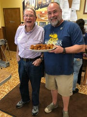 After making his special recipe for Robert St. John, from right, Billy Slay, 89, of Hattiesburg, has been dubbed the Hushpuppy Whisperer by the restaurateur.