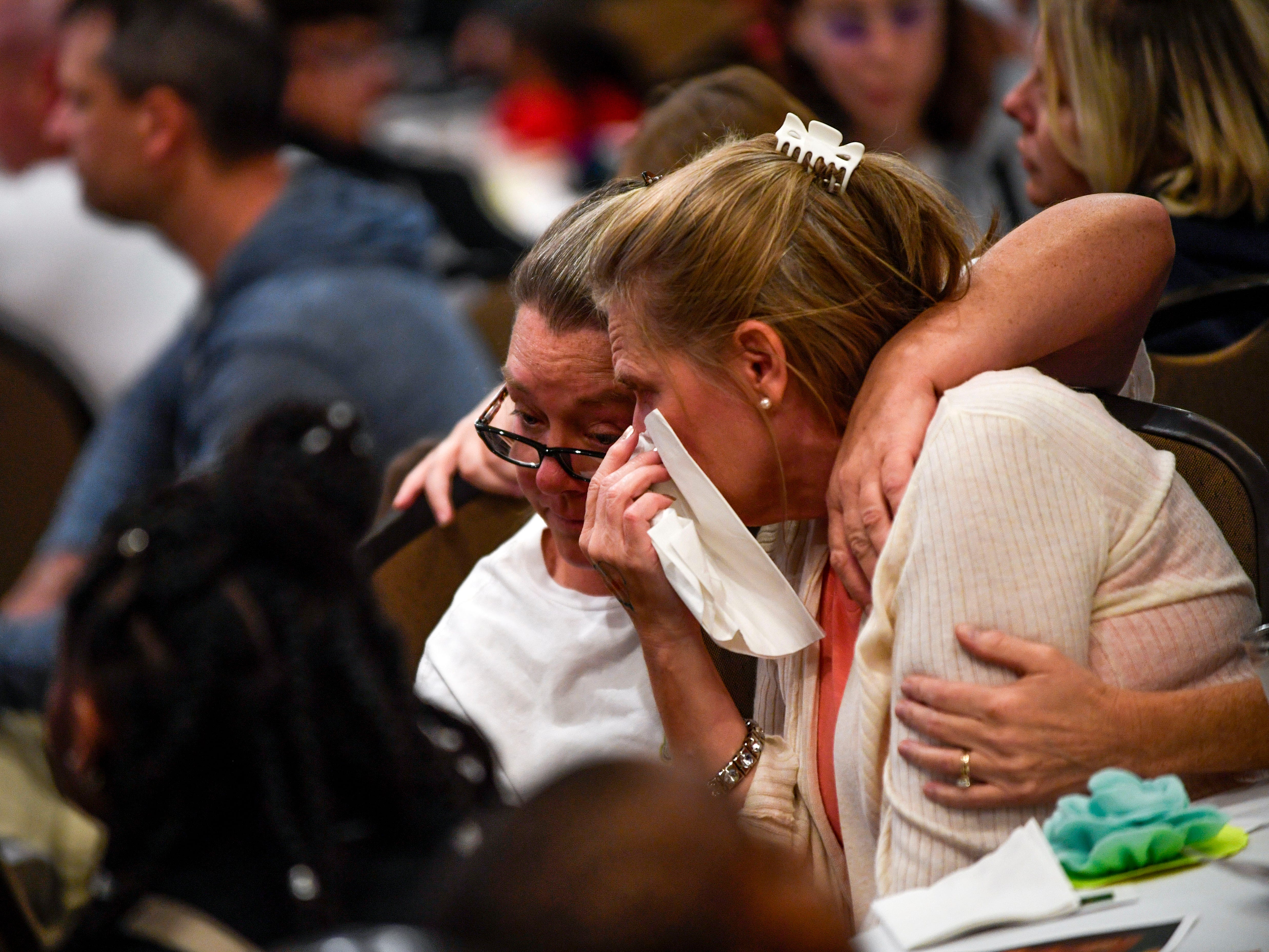 Brenda Pittman, right, is comforted by a friend of her sisters, Gina, who noticed Pittman tear up during the annual Remember Me Walk hosted at Union University in Jackson, Tenn., on Monday, Oct. 1, 2018. Pittman lost her son just weeks prior to the walk, and he was a student at Union University.