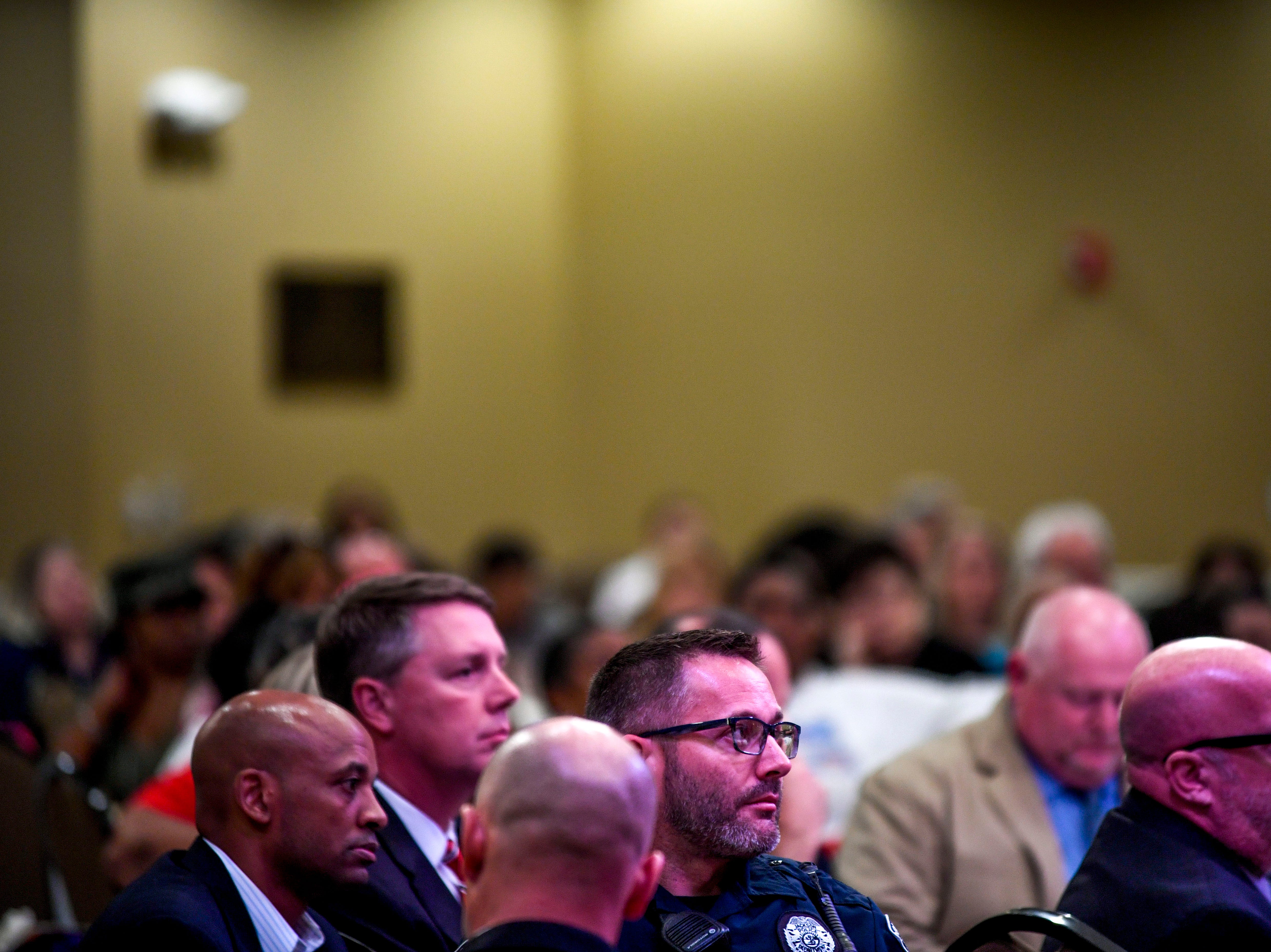 Officers from the Jackson Police Department listen to speakers during the annual Remember Me Walk hosted at Union University in Jackson, Tenn., on Monday, Oct. 1, 2018.