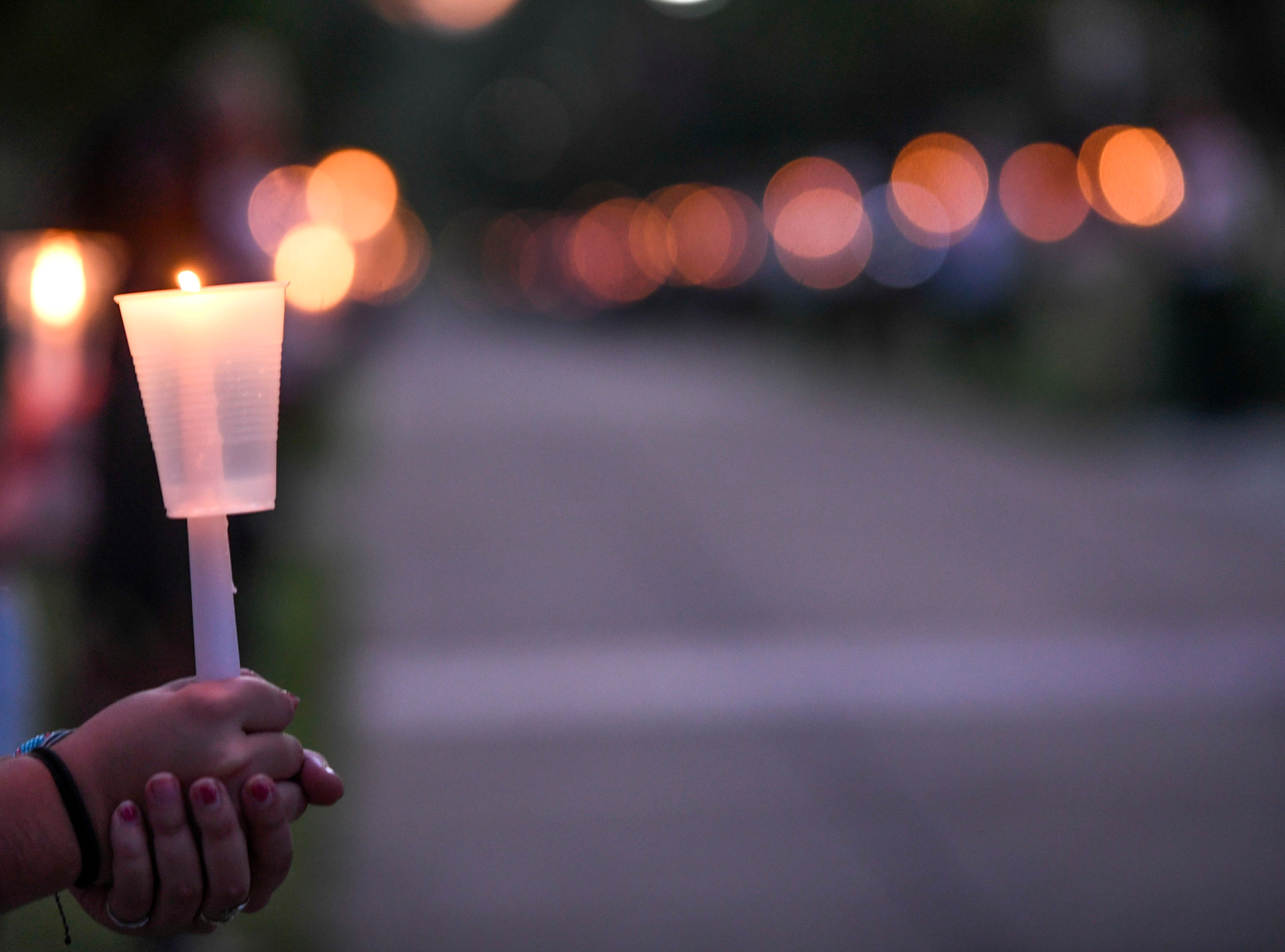 Union University students hold candles for the vigil walk during the annual Remember Me Walk hosted at Union University in Jackson, Tenn., on Monday, Oct. 1, 2018.