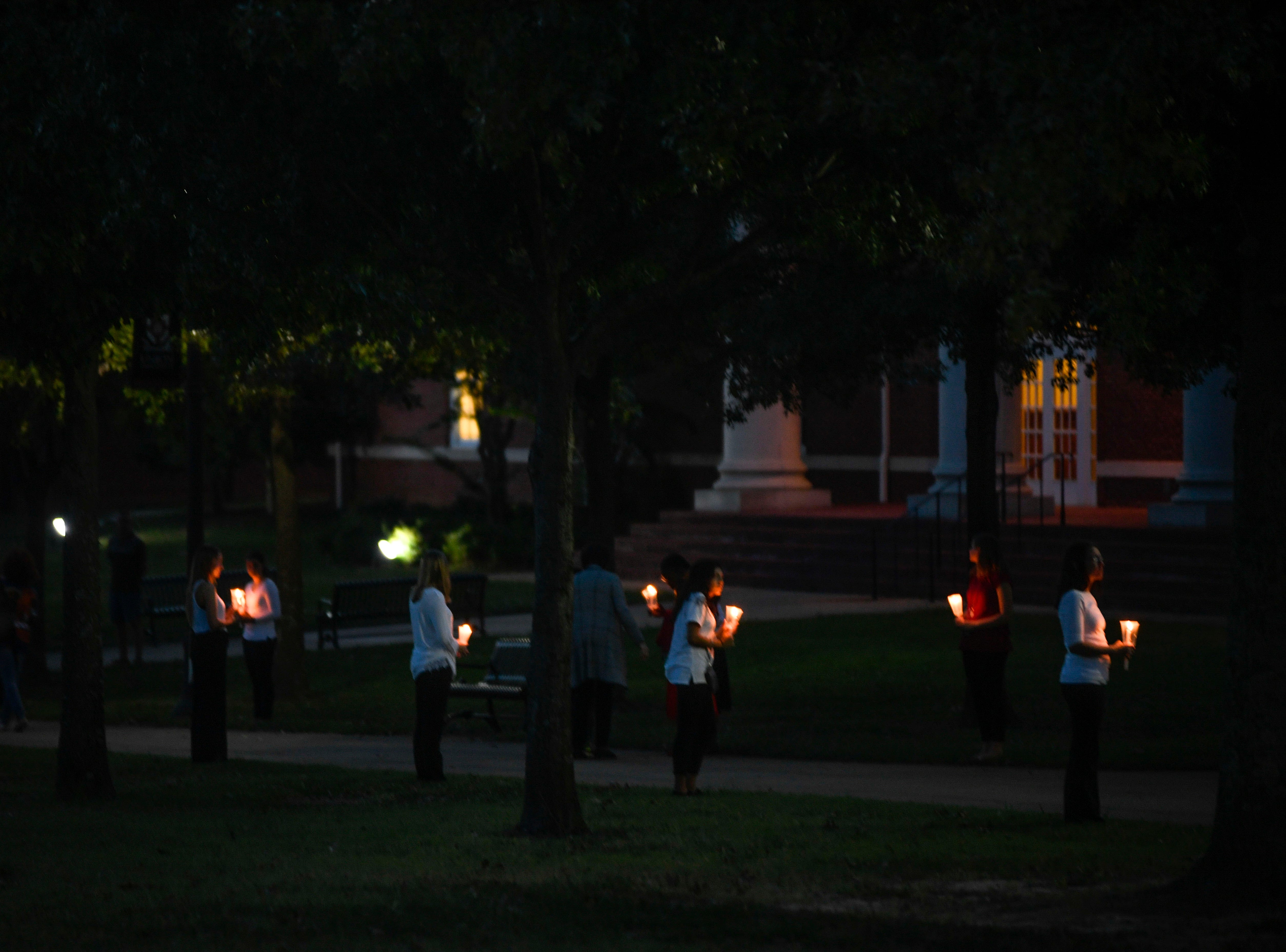 Union University students hold candles for a vigil during the annual Remember Me Walk hosted at Union University in Jackson, Tenn., on Monday, Oct. 1, 2018.