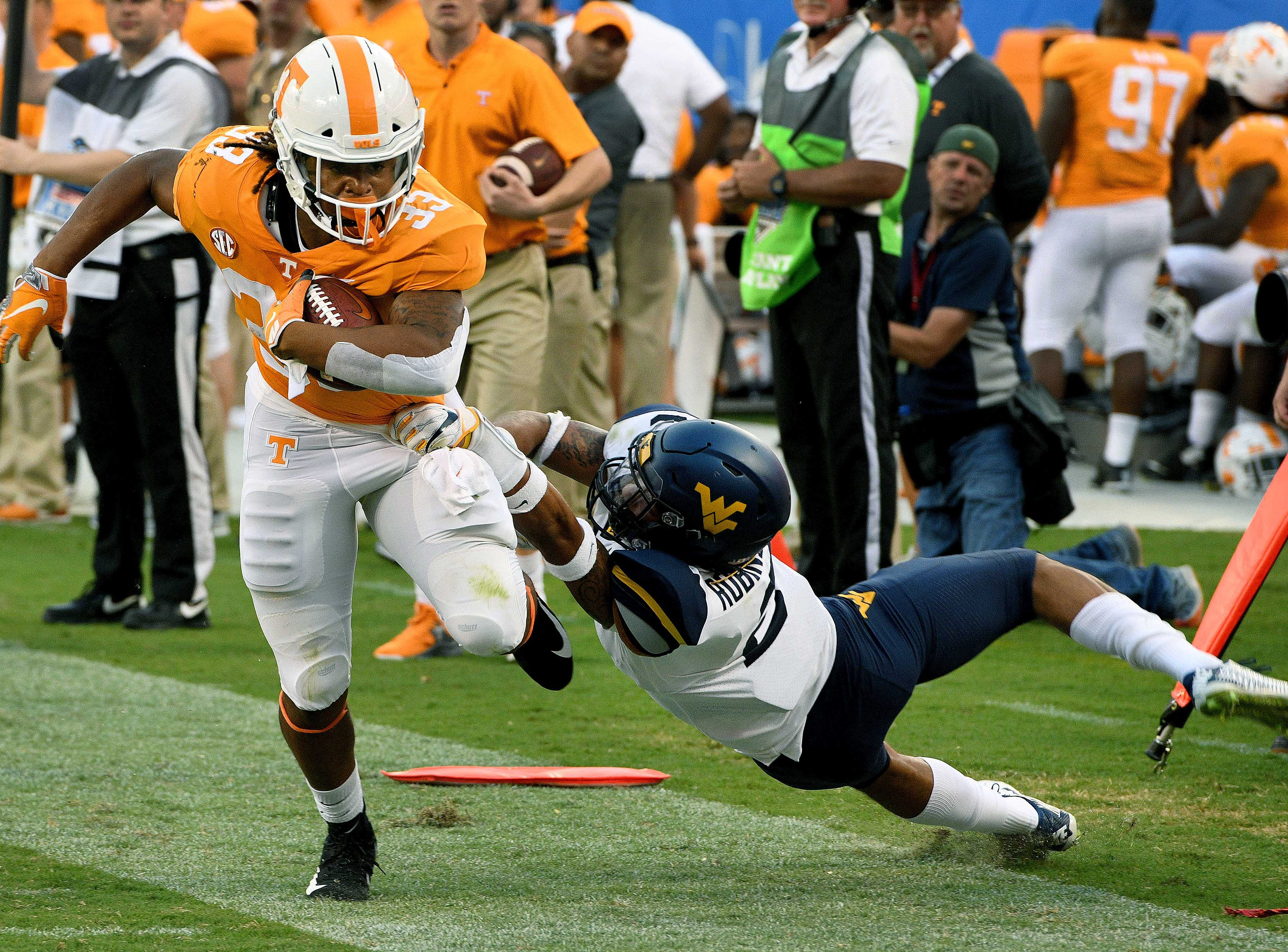 Tennessee running back Jeremy Banks (33) is pulled out of bounds during first half action against the West Virginia Mourtaineers in the Belk College Kickoff game in Charlotte, NC Saturday, September 1, 2018.