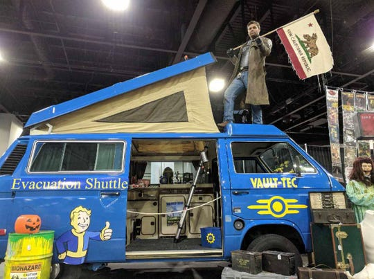 Justin Webb poses with a Volkswagen van he and his wife, Megan, transformed into an evacuation shuttle from the video game Fallout. The two plan to travel around the US in the van for one year.