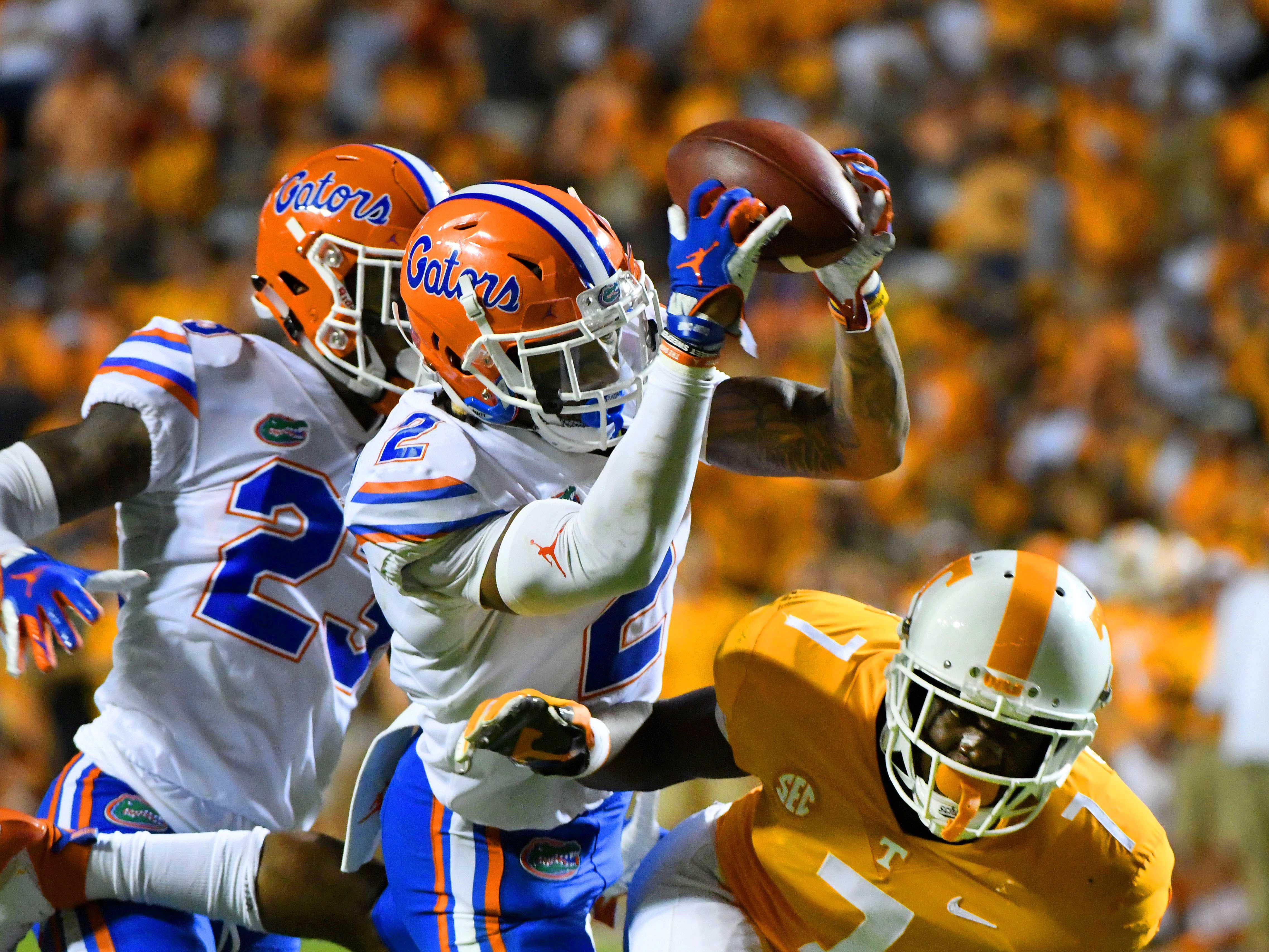 Florida defensive back Brad Stewart, Jr. (2) intercepts a pass intended for Tennessee wide receiver Brandon Johnson (7) during second half of their 47-21 win in Neyland Stadium Saturday, September 22, 2018 in Knoxville, Tenn.