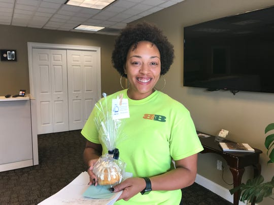 Deidra Harper, co-owner of B&B Lawn Services, is notified that she was selected as a Knox.biz 40 Under 40 honoree