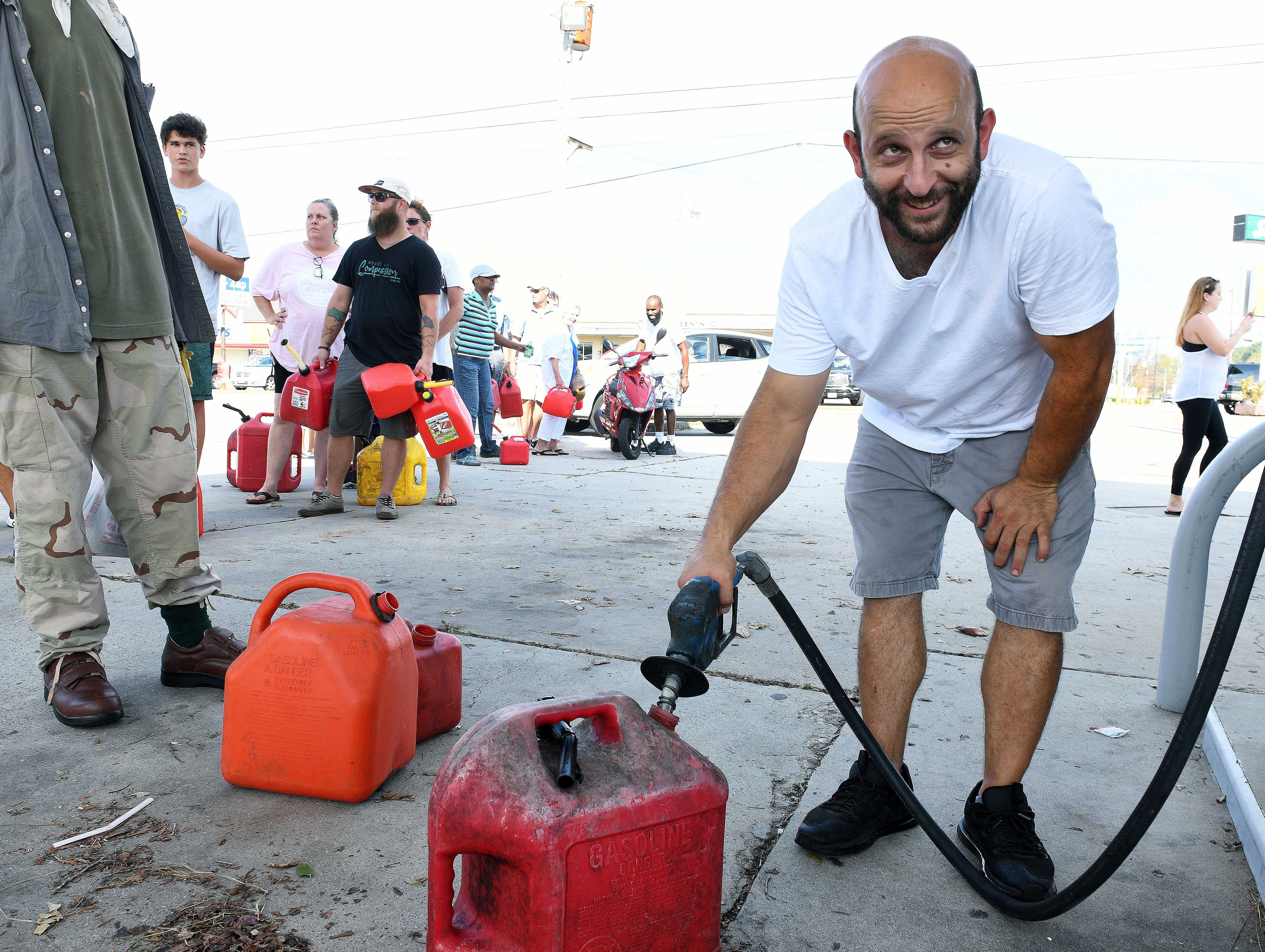 Yaser Abdelhamid helps his uncle dispense gas at the Sunoco station at 17th St in Wilmington following Hurricane Florence  Monday, September 17, 2018.