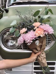 Flourish Flower Truck customers can create their own bouquet to keep or give to a loved one. Owner Savannah Pannell plans to offer bouquet subscriptions and make deliveries as the weather turns cold.